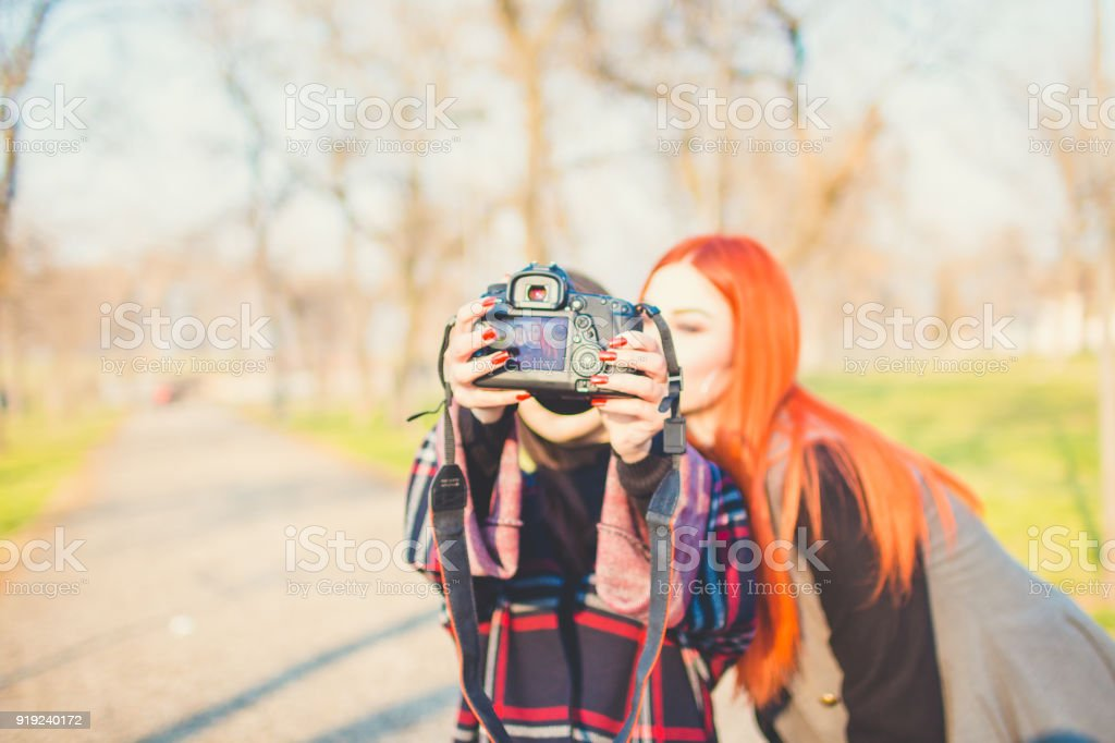 Two girls take selfie with camera. stock photo