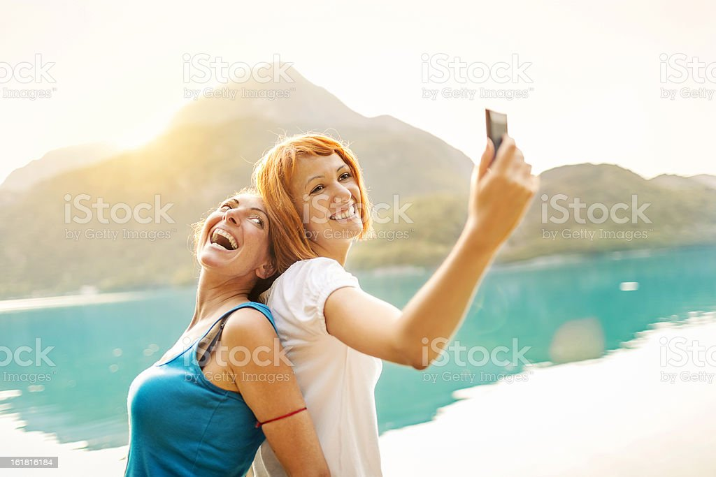 Two girls taking self photograph royalty-free stock photo