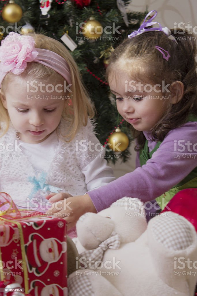 Two girls under Christmas tree royalty-free stock photo