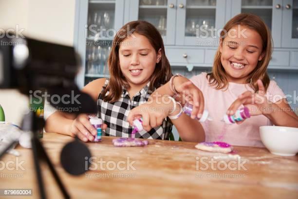 Two girls video blogging in kitchen preparing ingredients picture id879660004?b=1&k=6&m=879660004&s=612x612&h=baplj5gtjdn cnkh7mjeometjxz4wav2eqlvuklnqbo=