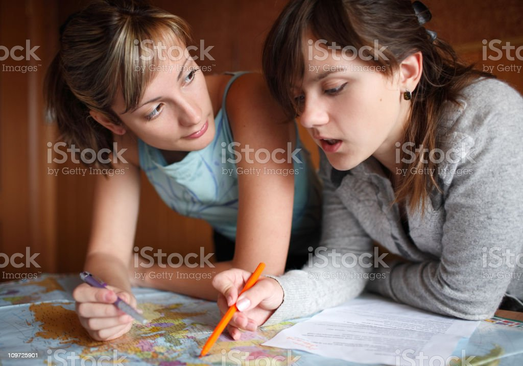 Two girls watching the map royalty-free stock photo