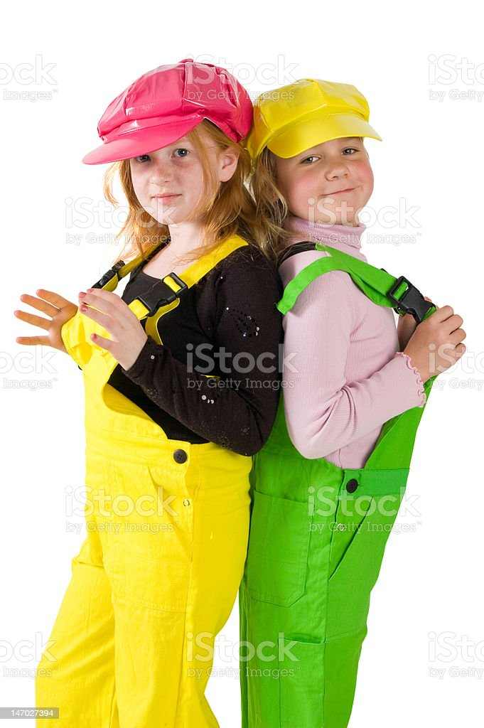 two girls wearing colorfull dungarees stock photo
