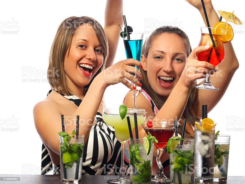 Two girls with a lot of cocktails stock photo