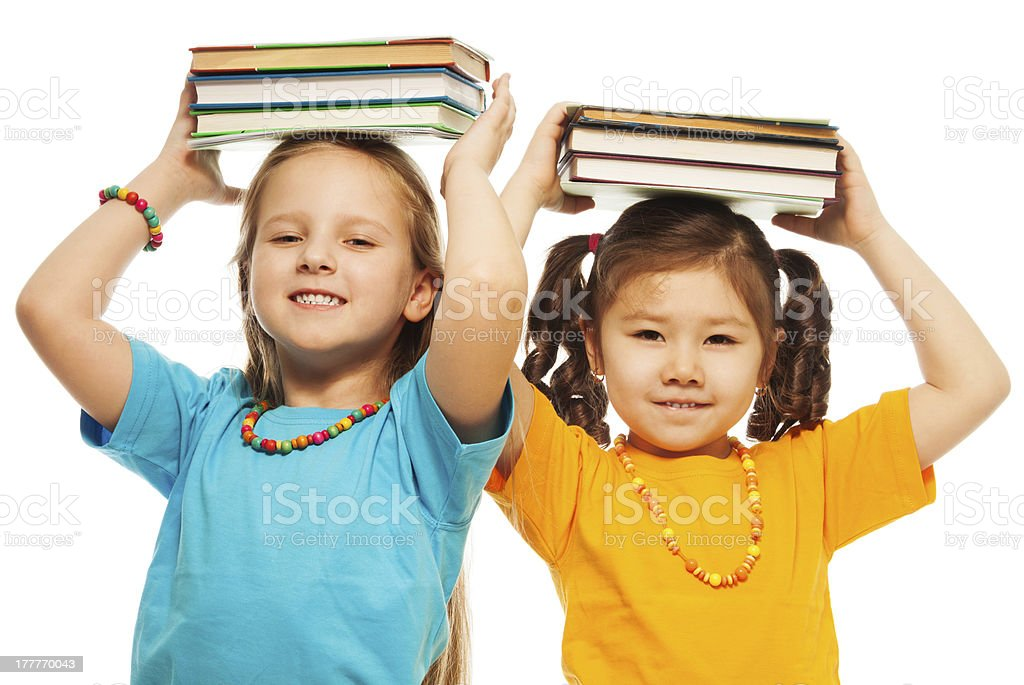 Two girls with books royalty-free stock photo