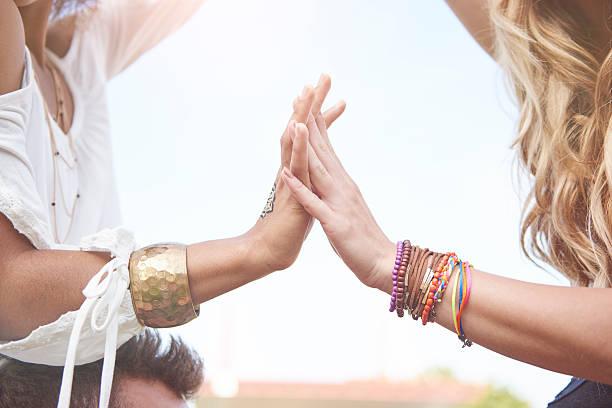 two girls with bracelets on hands - a zone armband stock-fotos und bilder