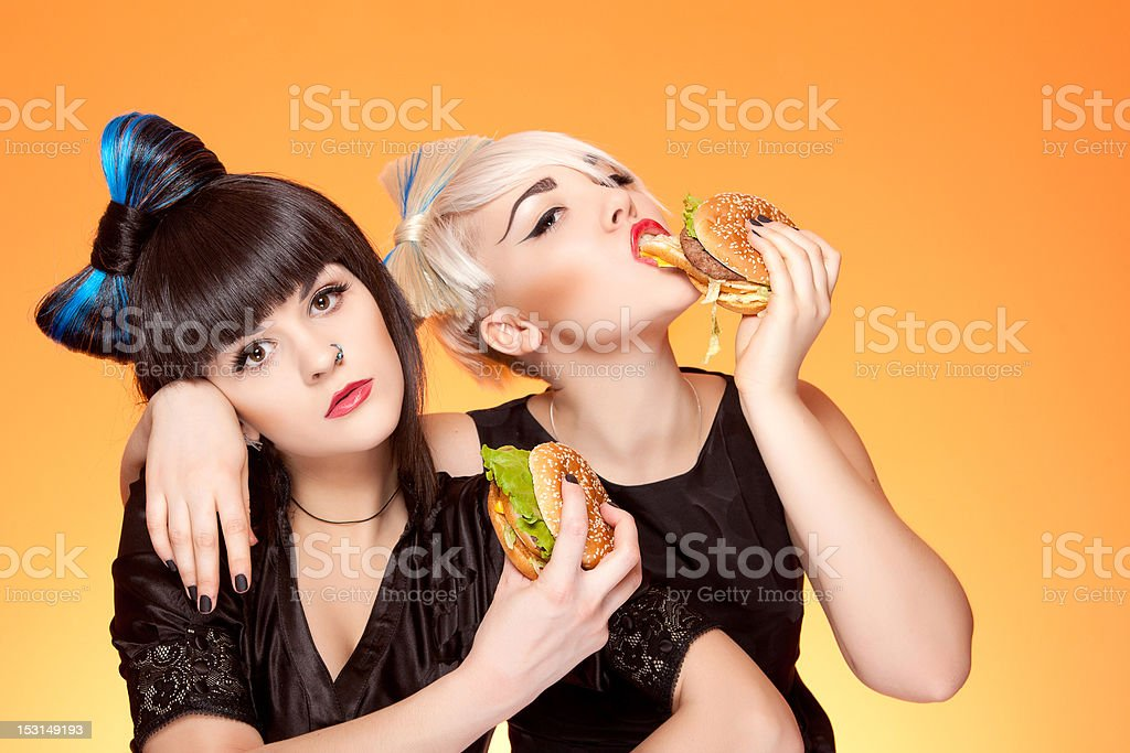 two girls with burgers stock photo