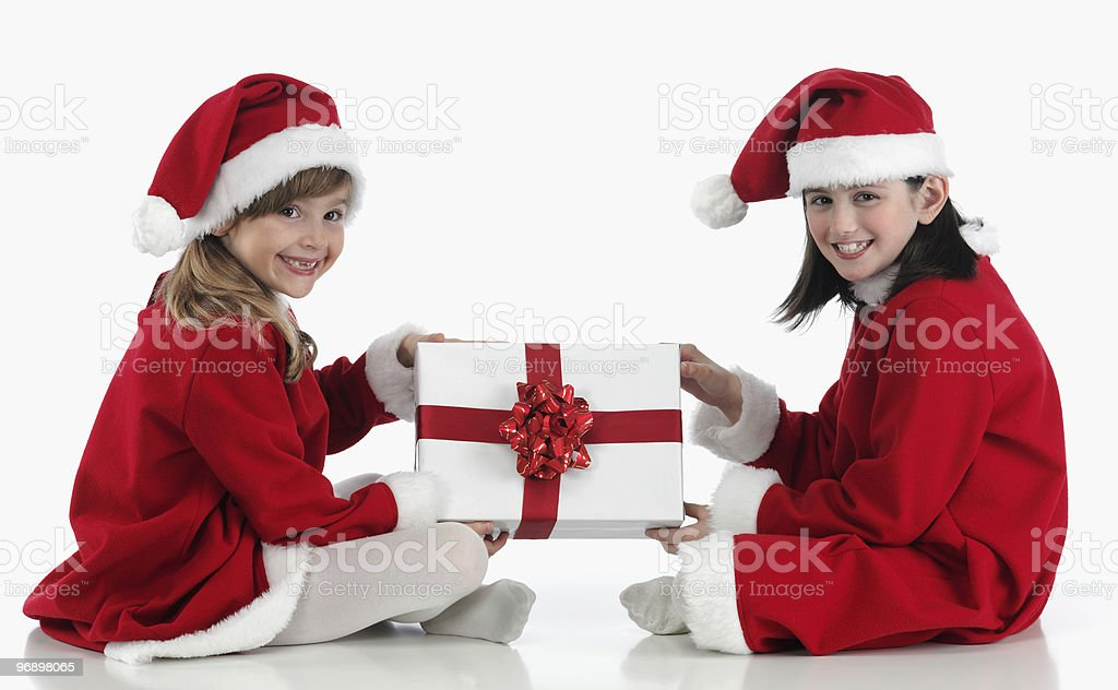 two girls with Christmas hat royalty-free stock photo