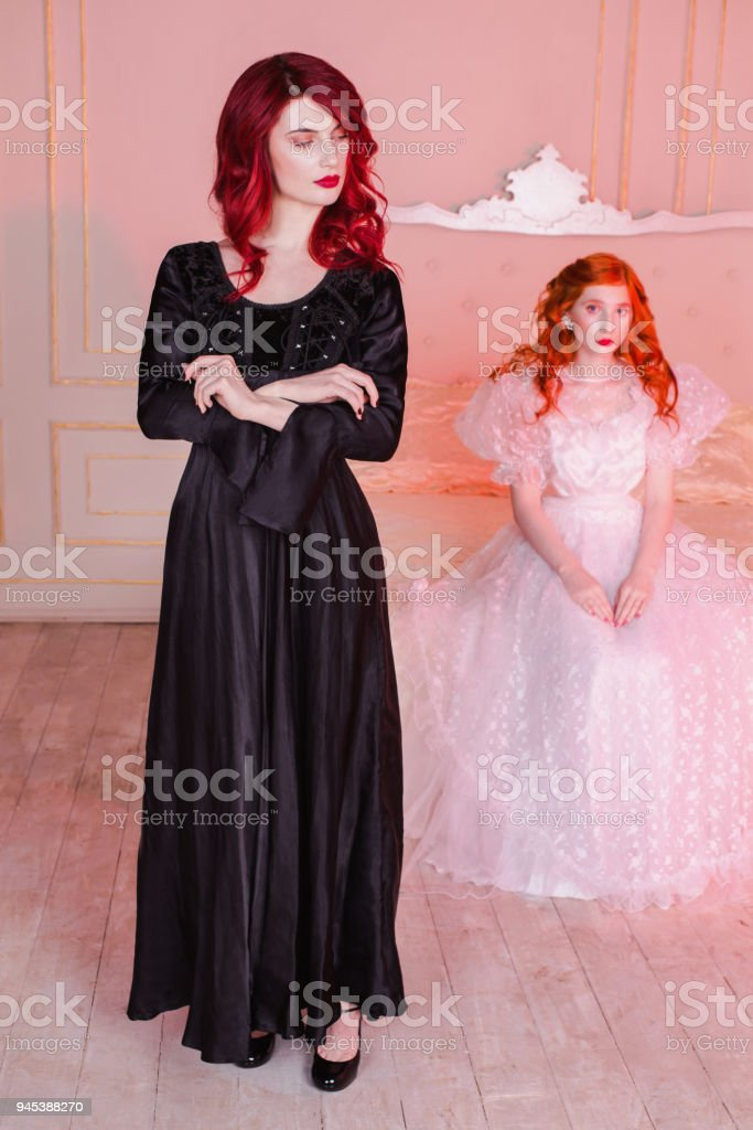 Two Girls With Red Hair In Retro Dress In The Bedroom Femme Fatale