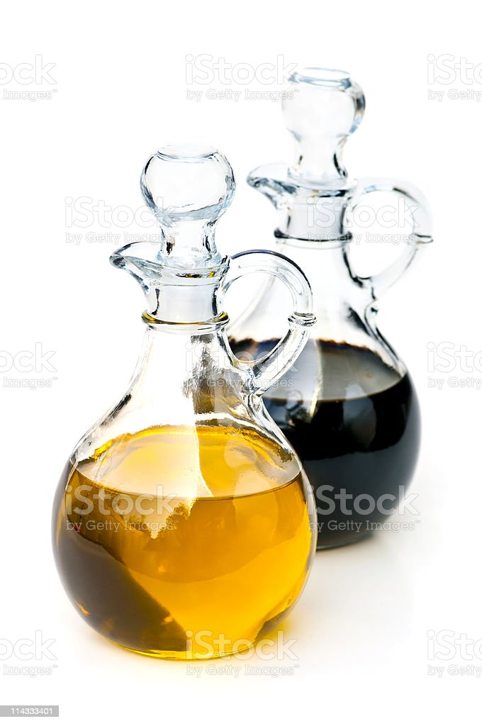 Two glass bottles containing oil and vinegar royalty-free stock photo