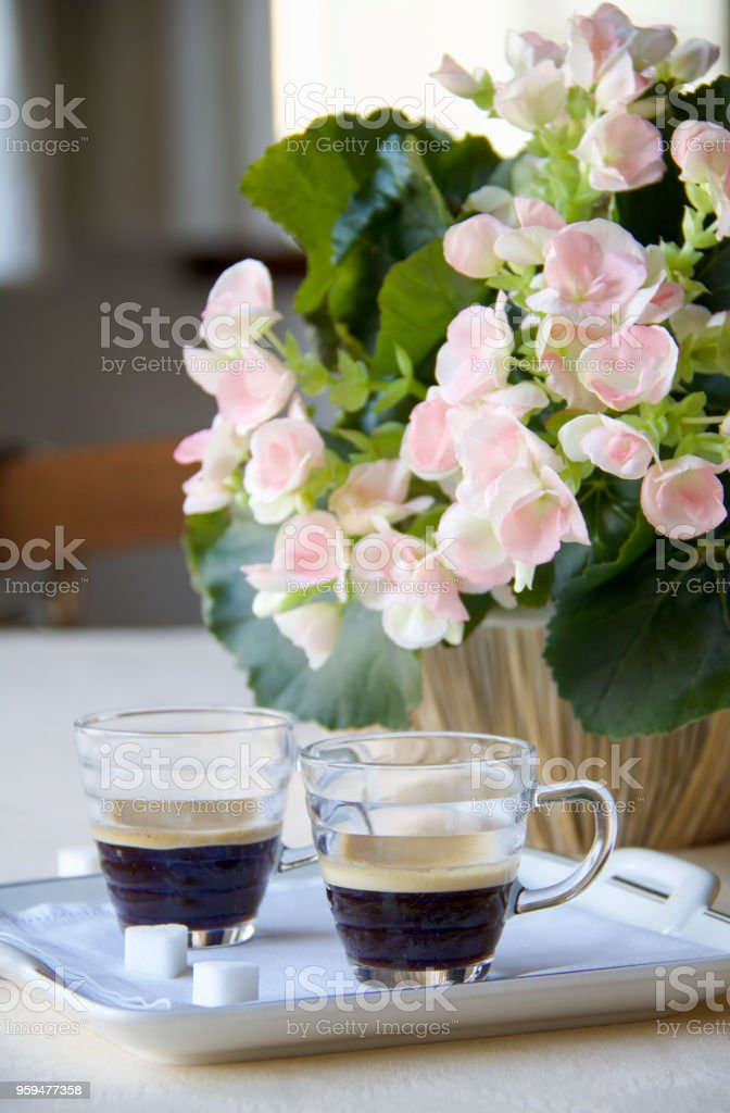 two glass cups of espresso coffee on the table ready for italian...