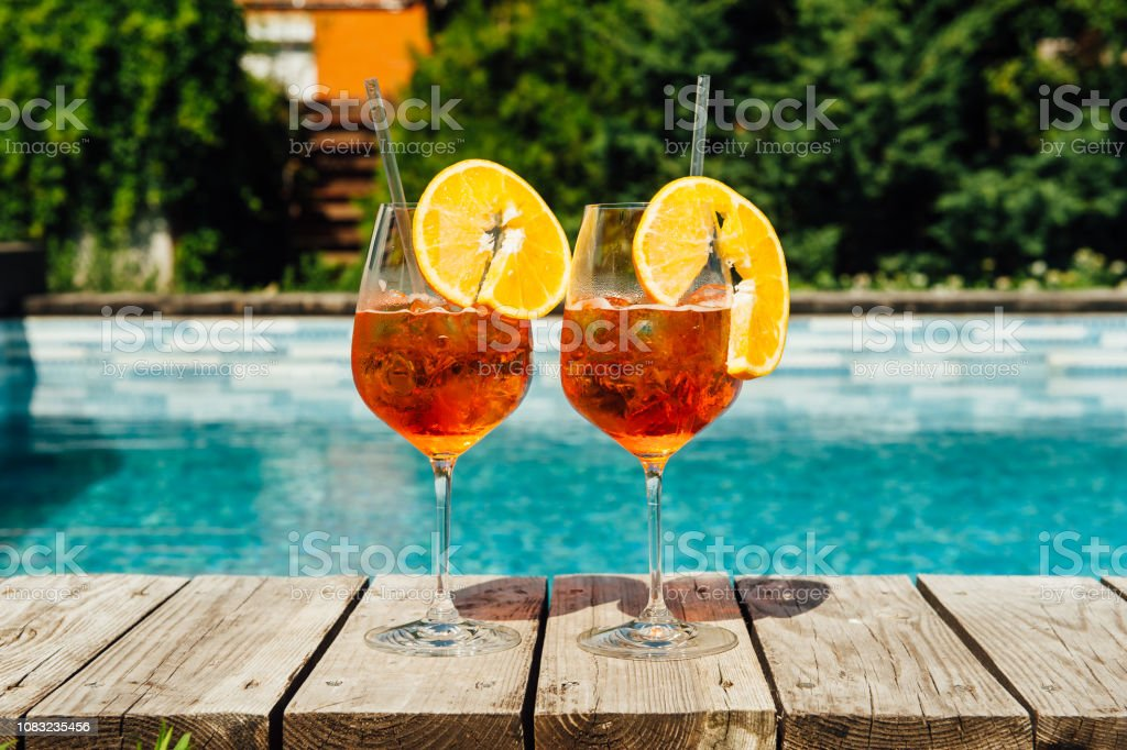 Two Glass of Aperol Spritz cocktail on the pool stock photo
