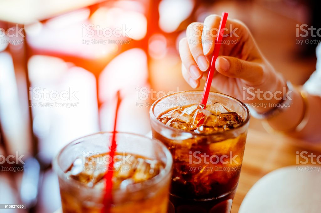 Two glass soft drink with ice in restaurant background stock photo