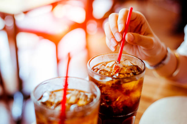 two glass soft drink with ice in restaurant background - soda pop stock photos and pictures