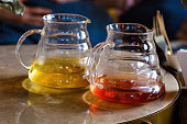 Two teapots with different colors fruit tastes of tea