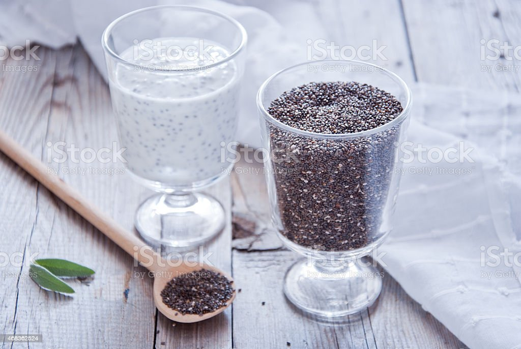 Two glass vessels with chia seeds and pudding, tabletop stock photo