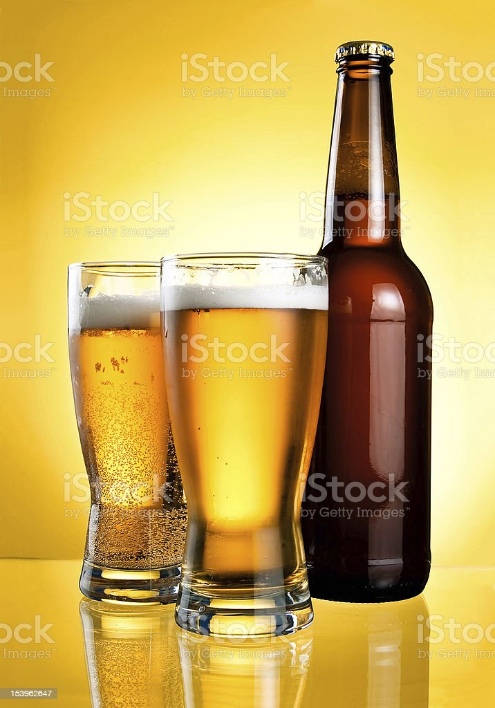 Two glasses and Bottle of fresh light beer royalty-free stock photo