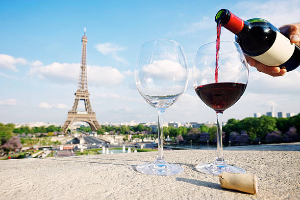 Two Glasses and Bottle of Red Wine at Eiffel Tower Two glasses and a fresh bottle of red wine overlooking the Eiffel Tower Paris french culture stock pictures, royalty-free photos & images