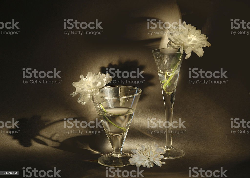 Two glasses and flower on  black background royalty-free stock photo