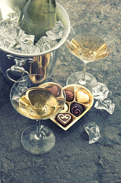 Two Glasses Bottle Of Champagne And Chocolate Stock Photo
