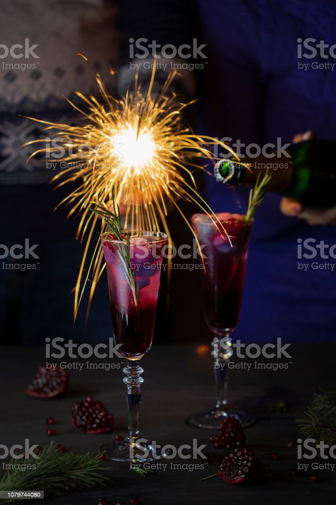 two glasses cocktail with pomegranate juice and champagne stock photo