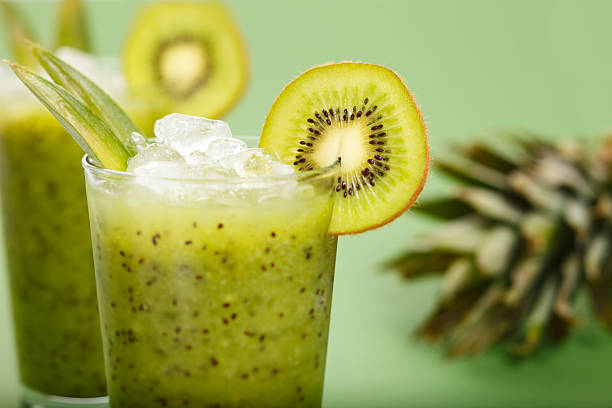 Two glasses filled with kiwi smoothies stock photo