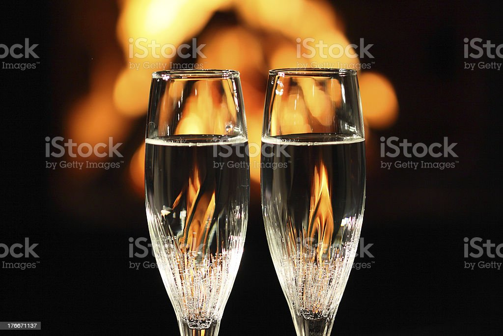 two glasses in front of fireplace royalty-free stock photo