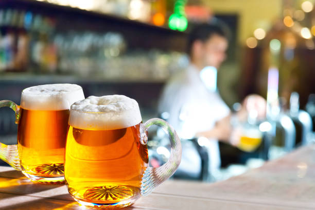 Two glasses of beer in the pub. stock photo