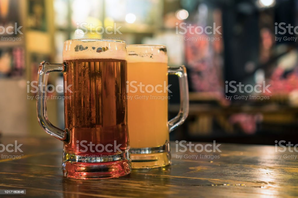 Two Glasses of Beer on the wooden table in bar and restaurant. relax...