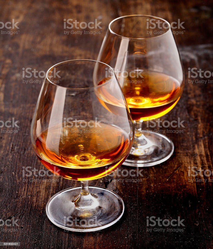 Two glasses of brandy stock photo