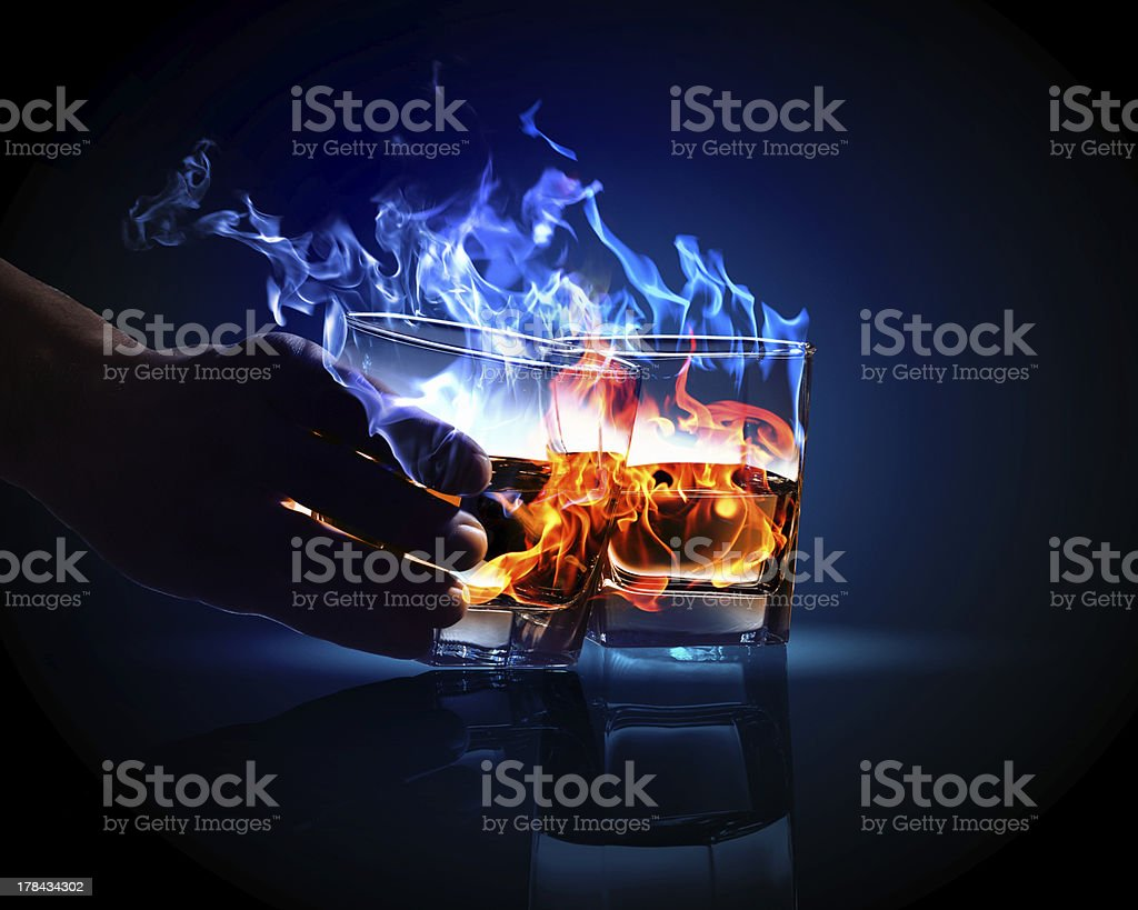 Two glasses of burning absinthe royalty-free stock photo