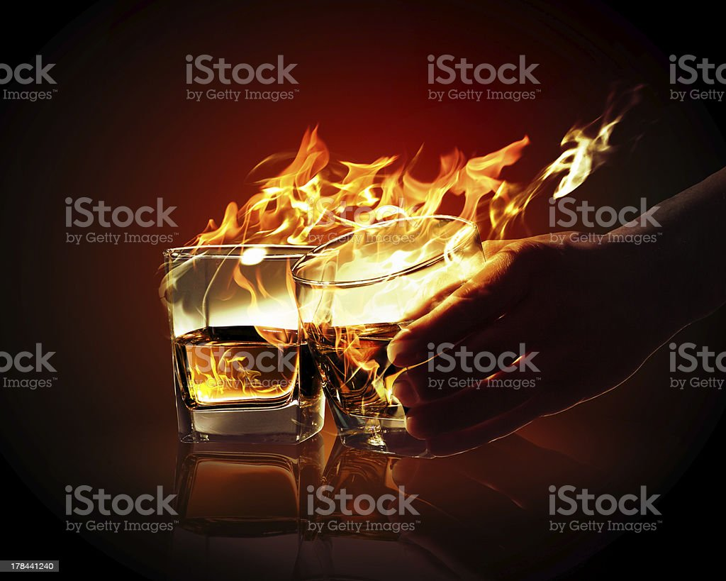Two glasses of burning yellow absinthe royalty-free stock photo