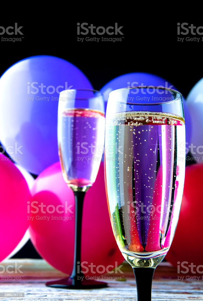 Two glasses of champagne and balloons on party royalty-free stock photo