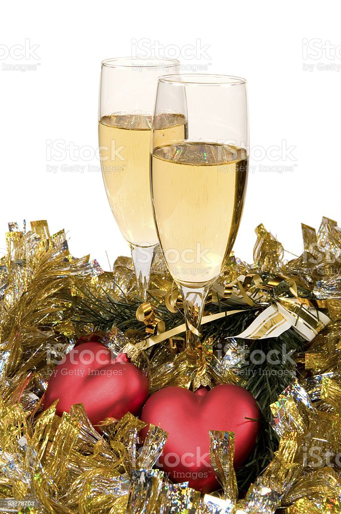 Two glasses of champagne and Christmas ornament royalty-free stock photo