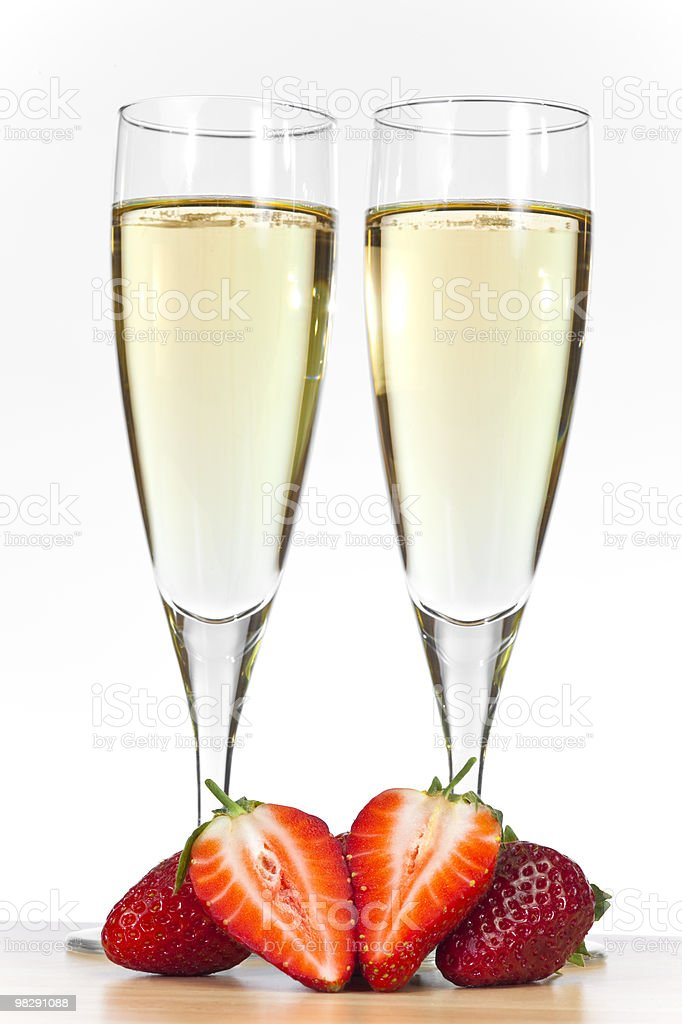 Two Glasses of Champagne and Strawberries royalty-free stock photo