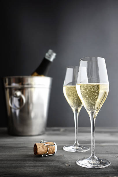 Two glasses of champagne, Cooler and Cork stock photo
