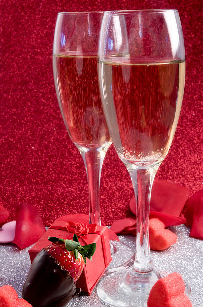 Two glasses of champagne in a romantic themed picture stock photo