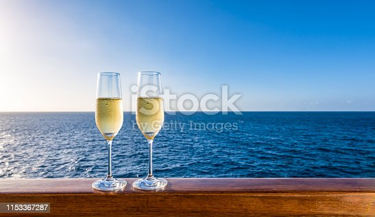 istock Two glasses of champagne on cruise vacation. 1153367287