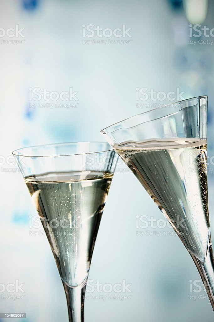 Two glasses of champagne toasting stock photo