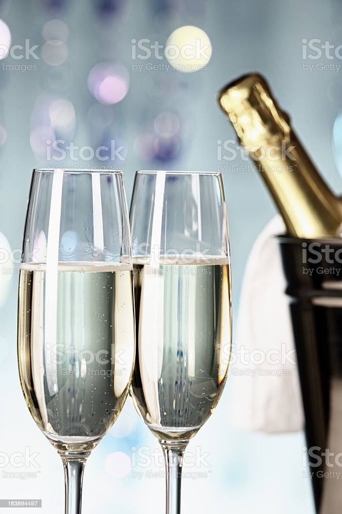 Two glasses of champagne with bottle in cooler stock photo