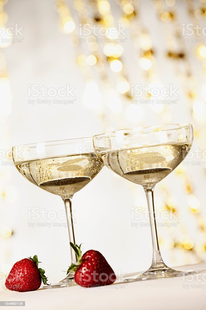 Two glasses of champagne with strawberries stock photo