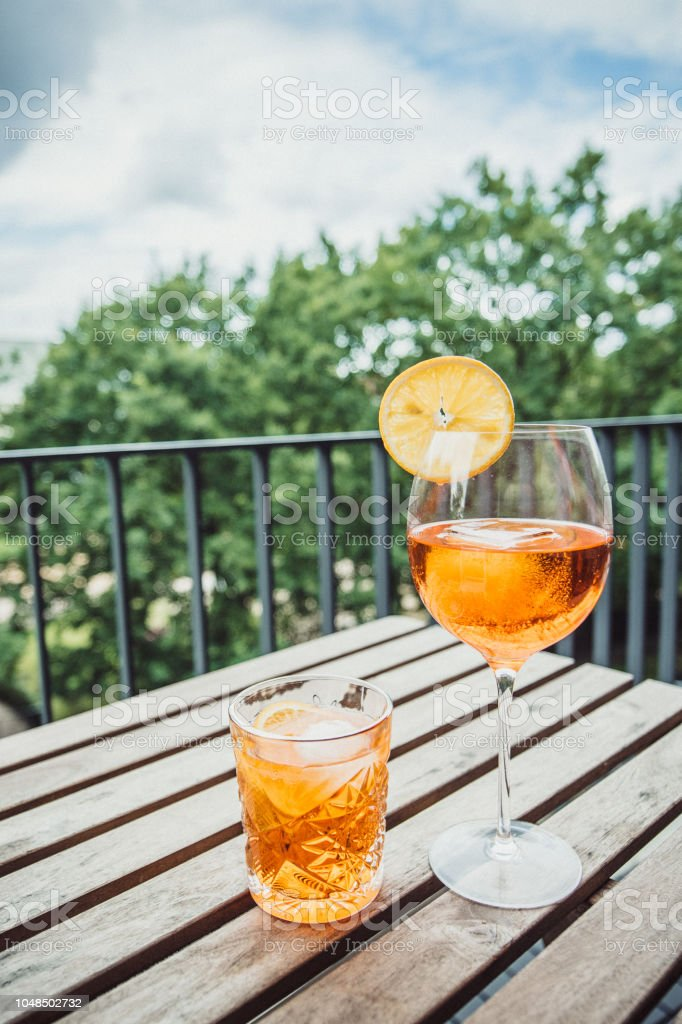Two glasses of cocktail on a balcony stock photo