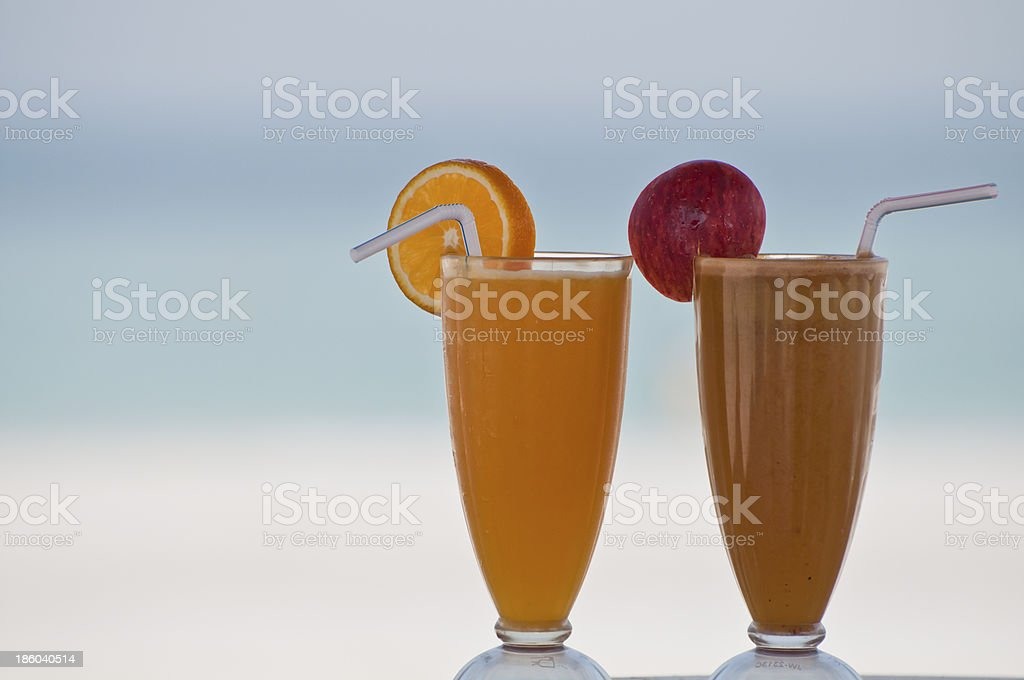 Two glasses of cocktails on a beach stock photo