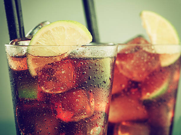 two glasses of cold rum cola - cold drink stock photos and pictures