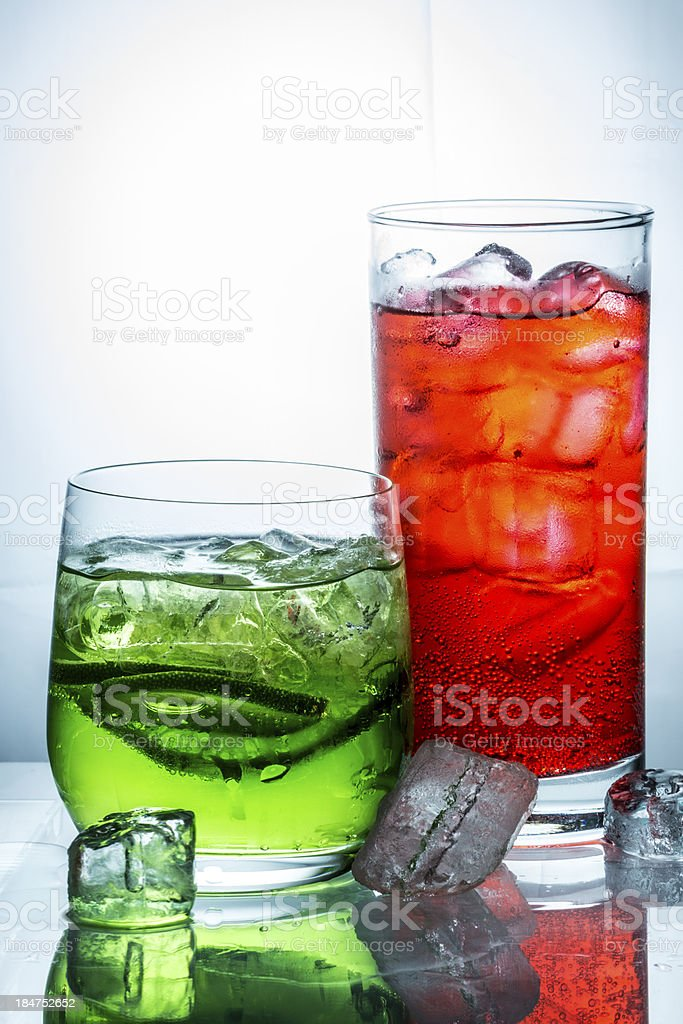 Two glasses of drinks and ice cubes royalty-free stock photo