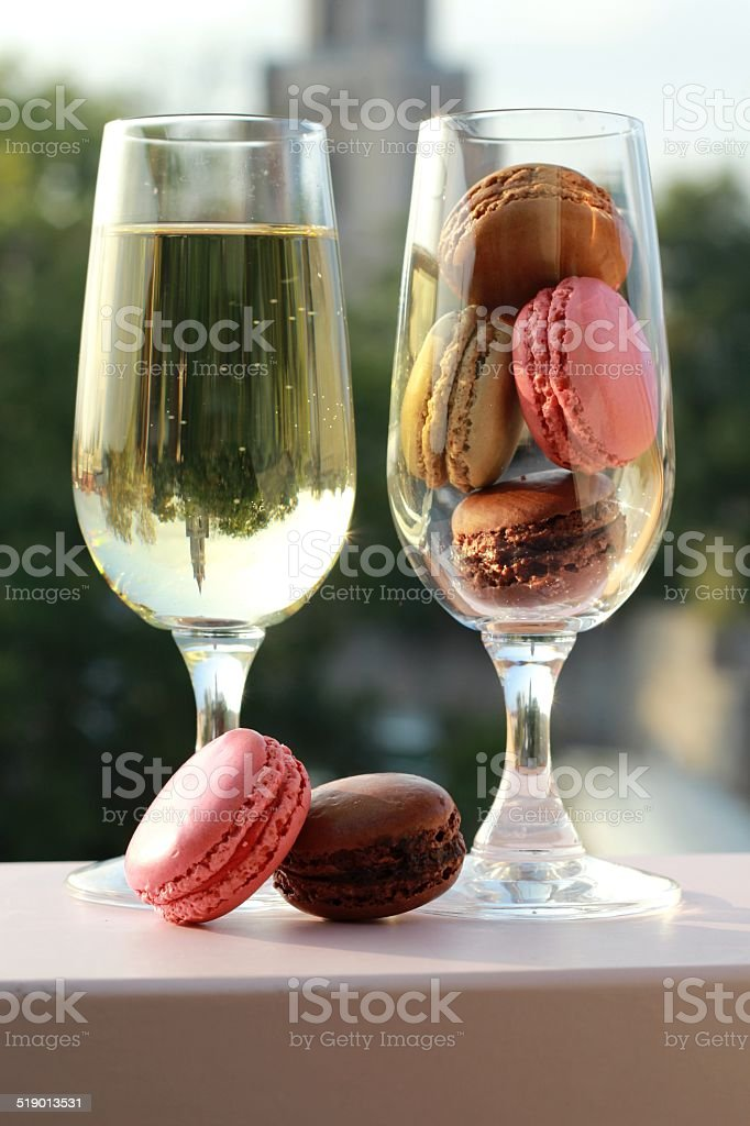 Two glasses of French macarons and champagne stock photo