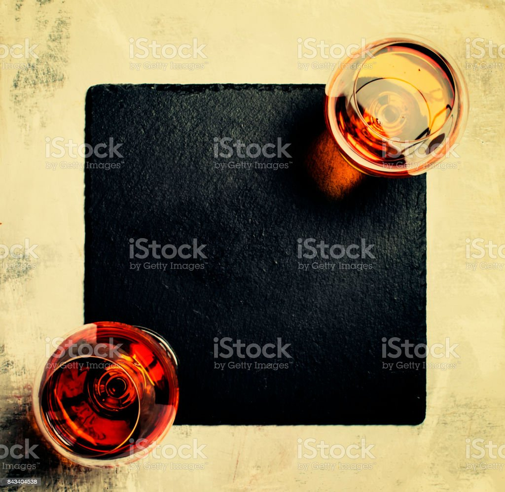 Two glasses of golden hard drink stock photo