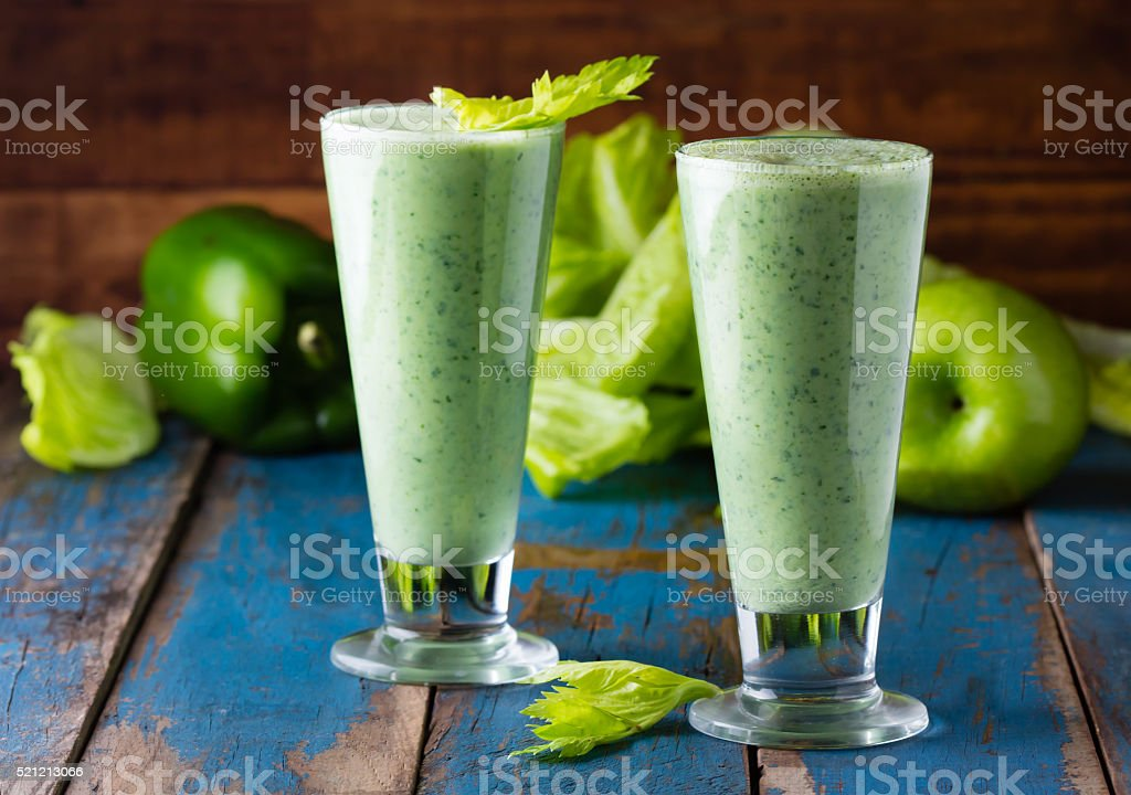 Two glasses of green smoothie, fresh vegetables and fruits stock photo