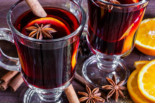 two glasses of hot mulled wine - mulled wine stock photos and pictures