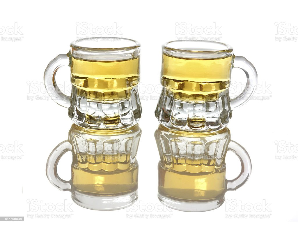 two glasses of hot shot brandy isolated royalty-free stock photo