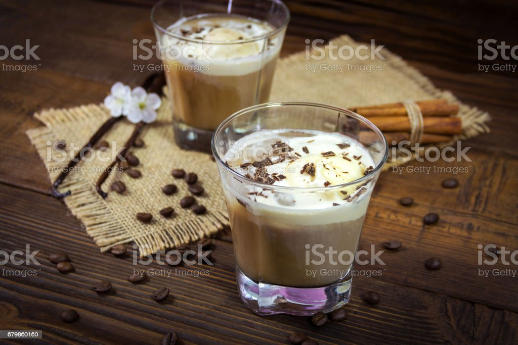 Two glasses of Ice coffe on wooden background stock photo